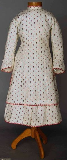 Girl's Dress (image 1) | 1870s | cotton, shell | Augusta Auctions | April 9, 2014/Lot 50