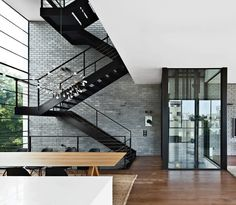 Amazing staircase, more amazing glass elevator. My house needs this.