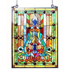 This Tiffany-style Victorian design window panel will add color and beauty to any room. Crafted from over 255 hand cut pieces of art glass, this window panel features tones of red, blue, green, yellow and white.