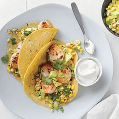 Shrimp Tacos with Corn Salsa | MyRecipes.com.  Easy summer weekday meal. Best when corn and avocados are in season. Find fresh corn tortillas if you can.