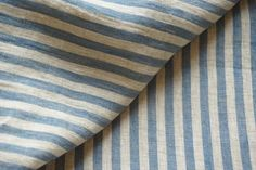 ✿ ✿ ✿ ✿ ✿ This is natural pure linen fabric. Fabric already washed. Delicate fabric with blue and light gray stripes. Stripes goes vertical. Great for any project. - Weight: 210 g/sqm. - Material: 100% linen, - Measure 146 cm x 100 cm.  ✿ ✿ ✿ ✿ ✿  Shipping: In Europe all cut fabric will reach the customer in 4-15 business days of payment. Everywhere Else: Between 7-45 business days of payment.
