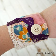 Textile cuff made from old quilt and other goodies. $20