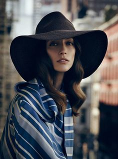 Made of sleek yet durable Toyo paper, Swanepoel's wide-brimmed St. Lucia hat is shaped by hand on vintage blocks in his Garment District studio. It is shown here as the sleek foil to an artfully wrapped silk shirt by J.W. Anderson.