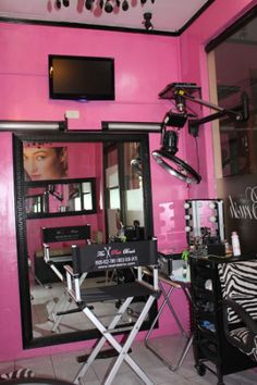 Luv the pink feature wall and tv mounted on the wall.