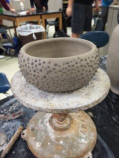 High School Ceramics, thrown bowl with slip trailing.