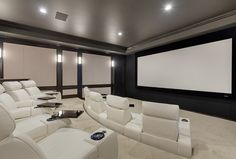 This is how I want to watch movies from now on… What an incredible home theater! The wall panels and chairs were provided by the theater company, Admit One Home Cinema. #hometheatre