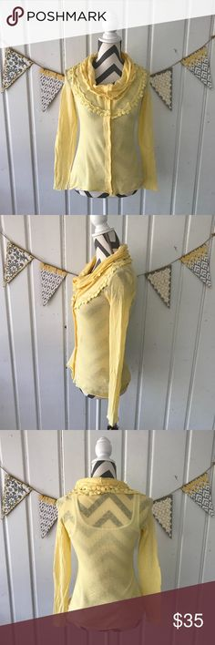 Anthropologie Knitted & Knotted Yellow Cardigan This pretty yellow cardigan, from Anthropologie, is perfect for spring! It buttons up to feature a cowl neck, and it has hanging knitted medallions adorning the top. It is in very good condition with a few small signs of wear. It has a small spot, near the neckline, and it also has a tiny pick, near the bottom (see the last 2 pics). These are not noticeable while wearing. It is very lightweight, and it is a bit see through. The true color is…