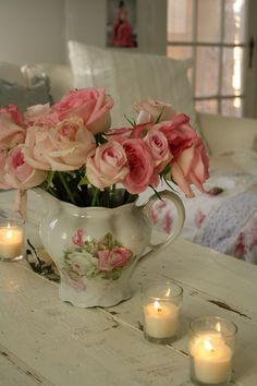 Cottage Home Décor...antique pitcher filled with soft pink roses...candles add to the romantic mood.