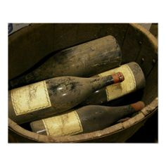Magnum bottles in a small wooden vat at Chateau Poster
