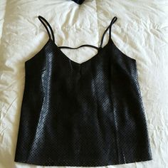 NWOT Faux Leather Tank w/ Overall Eyelet Tags off, but never worn. Faux leather tank with low back details, overall eyelet design with poly lining. Runs small, as it is a Jr's M Tops Tank Tops