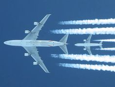 Emirates SkyCargo Boeing 747F freighter and a B777 in flight