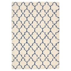 Anchor your living room seating group or define space in the den with this artfully tufted rug, featuring a quatrefoil motif for eye-catching appeal.
