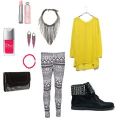 Aztec patterned leggings with studded shoes, clutch, and yellow sweater with neon pink accents. outfit