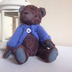 Handmade teddy bear toy. The chocolate bear is made from dark brown German viscose fabric. Bear toy has jointed legs and head (each on double joint), therefore all parts are naturally movable and he can take different poses. Chocolate bear has black glass eyes and is filled with the