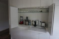 Well hidden kitchen gadgets and small appliances! Coffee machine, blenders, toaster etc behind handless bi-fold doors URL: www.interiorsinfocus.com.au