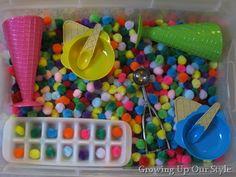 Et si vous mettiez des pompons de couleurs dans votre bac sensoriel?