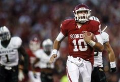 """Blake Bell on 3rd and 1 in the """"Belldozer formation"""" from the Oklahoma 45 broke through and rushed for a 55 yard touchdown against Baylor. The Sooners won 42-34 in Norman."""
