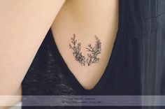 minimalistic side tattoo