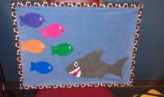 5 Little Fishes teasing Mr. Shark rhyme.  Also would work well with the Three Little Fish and the Big Bad Shark.