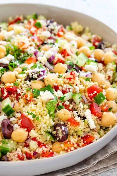 Mediterranean couscous salad with a fresh lemon herb dressing. Semolina pasta to… Mediterranean couscous salad with a fresh lemon herb dressing. Semolina pasta tossed with colorful vegetables, feta cheese, olives, and garbanzo beans. Best Salad Recipes, Veggie Recipes, Cooking Recipes, Summer Salad Recipes, Feta Cheese Recipes, Recipes Dinner, Grilling Recipes, Medeteranian Recipes, Summer Vegetable Recipes