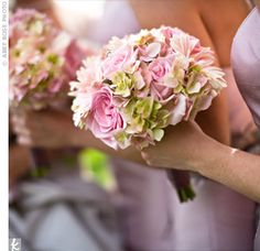 Bridesmaid Bouquet. Stephanie's bridesmaids carried bouquets made up of pink hydrangeas, roses, and gerbera daisies to match their pale pink dresses. The bouquets were wrapped in the same ribbon as the bride's to tie their looks together.