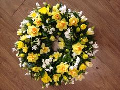 Daffodil Wreath (available in Spring only). Call 0208 500 8833 for details Funeral Flower Arrangements, Funeral Flowers, Floral Arrangements, Faux Flowers, Fresh Flowers, Funeral March, Casket Sprays, Plant Science, Daffodils