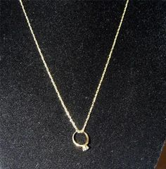 10 kt Gold Necklace with 10 kt gold Blue Topaz Ring Pendant 35.00