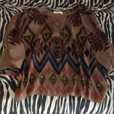 A'gaci boho tribal blouse This is an adorable tribal looking a'gaci flowy boho blouse! cute when worn with jeans! It has slits on both shoulder parts of the shirt for skin exposure (bought that way) a'gaci Tops Blouses
