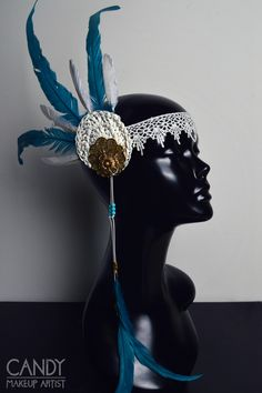 An handmade very light weight headdress. Ideal for parties, festivals and events or if you want to wear it all day long. The decoration is on the right side of the head It's decorated with several handmade ornaments, feathers, lace, rhinestones and many more small details The headdress is made with an elastic band on the back for a good fit.  100% handmade
