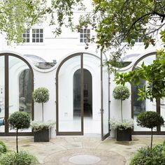 A Sensitive Edwardian Conservatory Retrofit with Curved Glass Ceilings