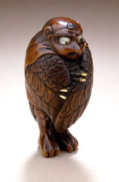 Netsuke, tengu (long‐nosed goblin), early 19th century, Wood with inlays, 1 15/16 x 1 1/16 x 15/16 in. (4.9 x 2.7 x 2.3 cm)