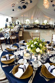 Navy Blue Tablecloths, Wooden Chargers, and a hint of green completes this serene tablescape.
