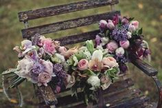 amazing colors of spring flowers on little distressed bench