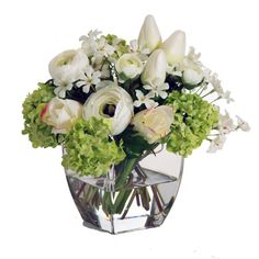 A delightful mix of soft greens, creams and whites, this bouquet includes ranunculus, mini tulips, snowball clusters and more. Everything is conveniently gathered together in a stylish glass vase. Liquid Illusion fake water adds additional realism.