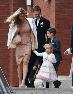 Pretty: The 35-year-old supermodel held on tight to daughter Vivian Lake as they exited Ce...