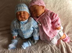 Hand knitted outfits for twins boy and girl.  via Etsy.