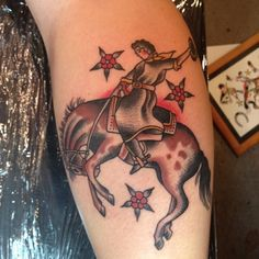 Cowgirl riding a bronc traditional tattoo