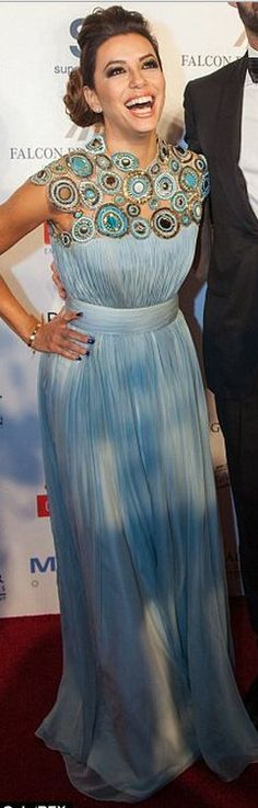 Eva Longoria's blue pleated gown that she wore in Dubai jaglady