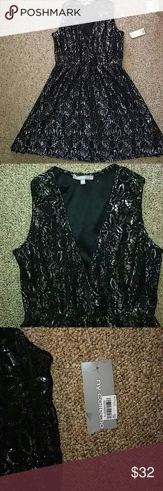 Nwt NY Collection lace dress NY Collection black and silver lace dress; a line; size large; nwt; fully lined; a little stretch; very feminine; NY Collection Dresses Midi