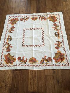 This is an adorable 1950s linen tablecloth with Roosters, hens, and chicks running about!  There is also a quaint barn printed on it  Measurements: 48 inches (4 feet) X 48 inches (4 feet)  Square  Colors: Off-white background, rusty brown, deep orange, gold yellow, dark beige, black  Colors are bright with no fading, no stains or holes, in excellent condition. Clean.  Perfect for your rustic farm kitchen. Rare to find these linens in this condition.   ***READ BEFORE YOU BUY *** This item is…