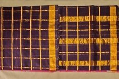Check patterned traditional purple shaded saree.