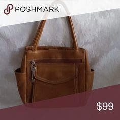 """🔥Upcoming🔥 Fossil medium brown handbag and silver key. Outside zip pocket and envelope pocket. Center zip compartment separates two other compartments.    Bag measures 11"""" wide x 8"""" tall x 3 1/2"""" base. Handles add about 6"""" to height.   Excellent used condition. Smoke free and pet free home.   Check out my other listings - 100's of 👠shoes👠, 👢boots👢 and 👜bags👜. Bundle 2 or more and save money!💲💰💲 Bags Mini Bags"""