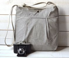 WATER PROOF Diaper bag Black and Ecru French Ticking striped Pleated French Messenger - 10 Pockets. $79.00, via Etsy.