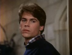 Pin for Later: 15 Movie GIFs That Prove Rob Lowe Has Been Sexy Since the Dawn of Time Even though he's not really a great guy in the movie.