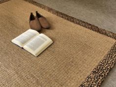This rug combines natural materials such as sisal and wood fiber obtaining a warm and contemporary texture. Thanks to our braided borders we get a nice mix between rustic and contemporary looks. Also available as a wall to wall carpet.