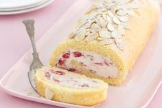 Delicate sponge layered with cream and strawberries makes this pretty roulade a luxurious dessert!