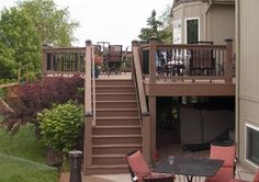 EverGrain Deck with color matched stained Cedar Handrails and Moonlight Decks Post Lights in Shawnee, KS