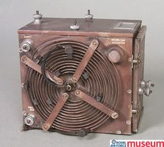 Wireless transmitter.    This wireless transmitter was used by the Royal Flying Corps to relay messages from the air, to wireless operators on the ground. It was attached to the side of an aircraft on a tray and required maintenance after every flight.