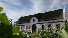 Casa com caracteríscas do estilo holandês, em Stellenbosch, África do Sul.