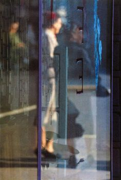 By Saul Leiter, 1 9 5 6, Walking. © Saul Leiter  Courtesy: Saul Leiter, Howard Greenberg Gallery, NY.